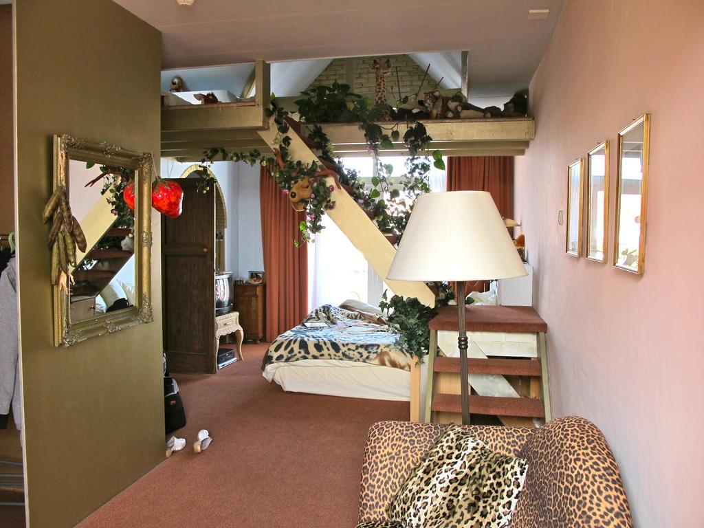 Bild Dschungelzimmer zu Hotel Hoogland in Zandvoort