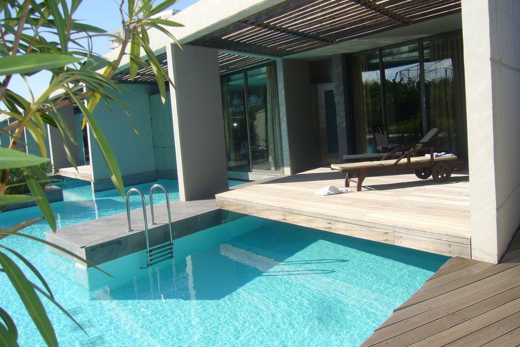 bild bungalows mit privatpool zu hotel kervansaray lara in lara. Black Bedroom Furniture Sets. Home Design Ideas