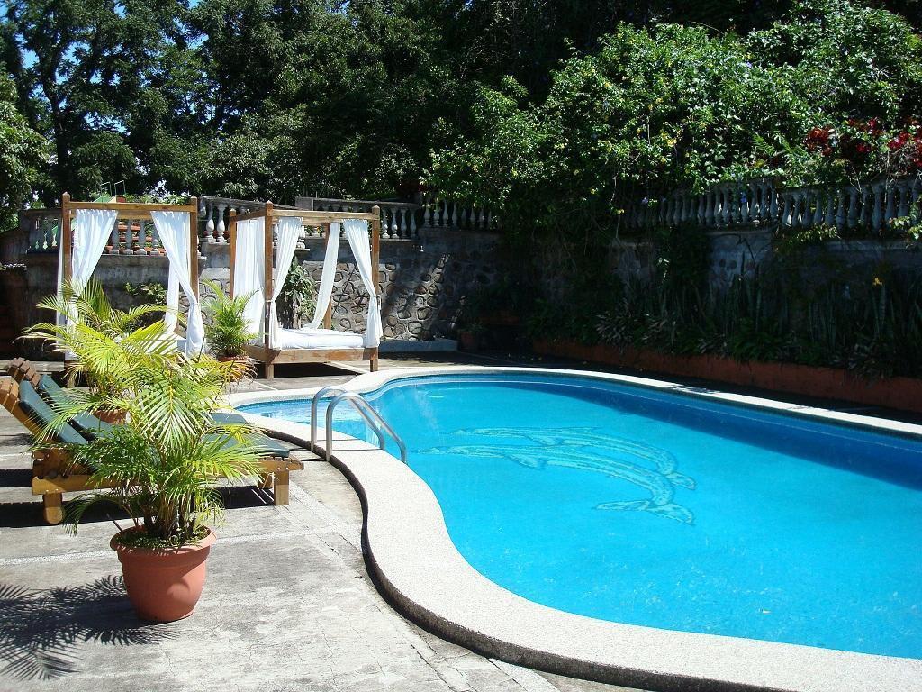 Bild Clothing Optional Swimming Pool Zu Hotel Suites La Catalina In Heredia
