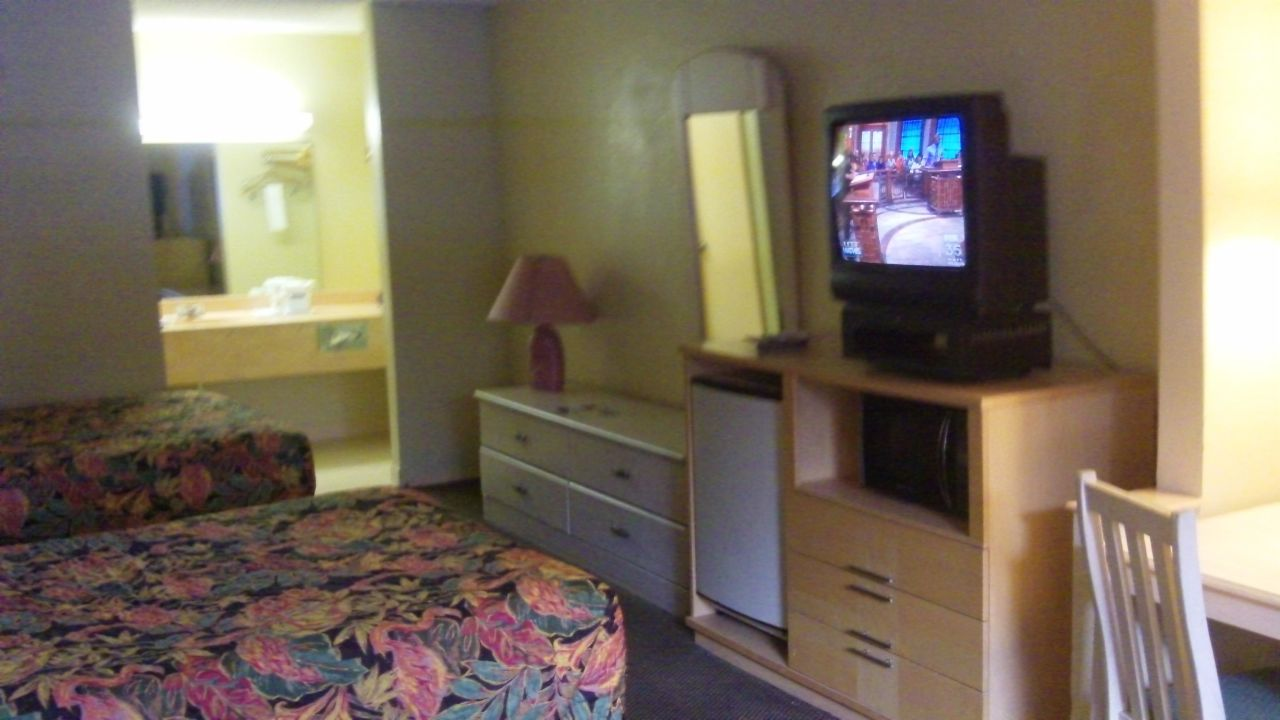 hotel travelodge suites east gate orange celebration. Black Bedroom Furniture Sets. Home Design Ideas