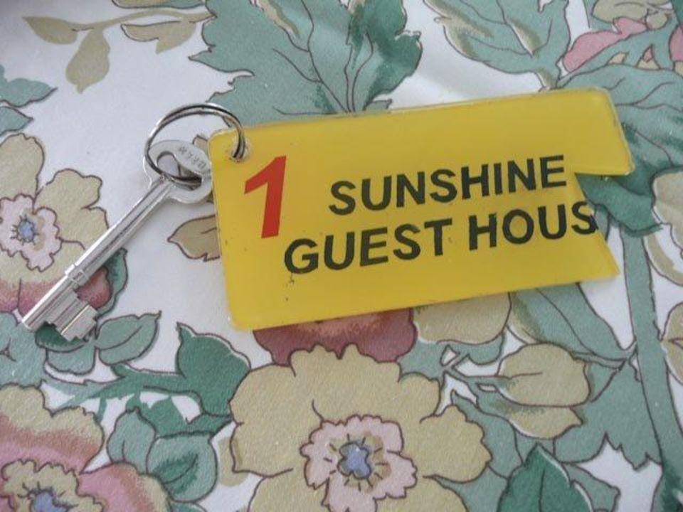 Zimmerschlüssel als Vorwarnung Sunshine Guesthouse