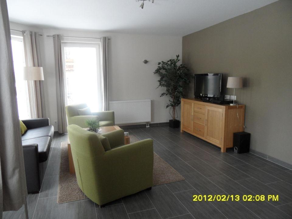 Wohnzimmer mit sitzecke und fernsehschrank ferienpark landal salztal paradies bad sachsa - Sitzecke wohnzimmer ...