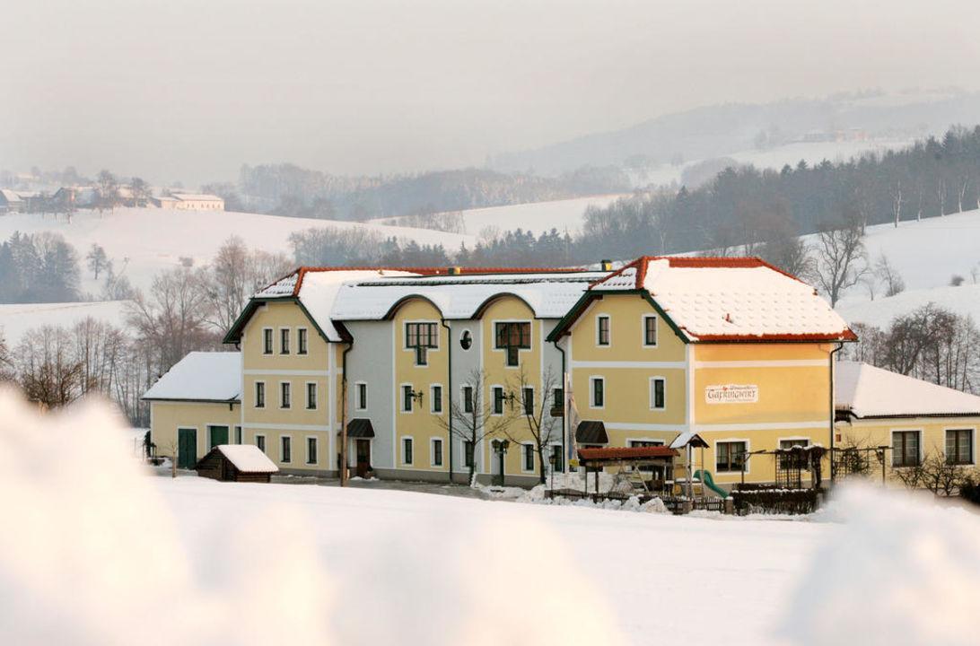 Haus im Winter Landhotel Gafringwirt