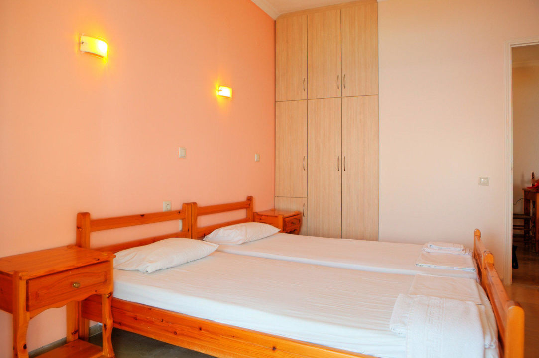 One of the two bed rooms with AC, sat TV, Wi Fi. Villa Alexandra