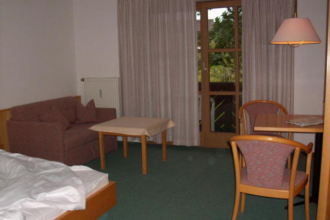 Wohnraum mit Balkon im Appartmenthaus Hotel Gottinger