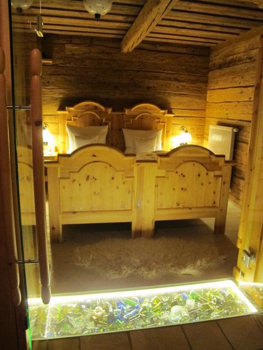 """Bild """"Schlafzimmer"""" zu Bergdorf Hüttenhof - Luxus Chalets in Grainet"""
