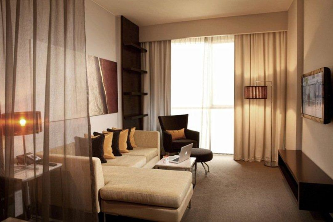 One Bedroom Suite Living Room Hotel Centro Sharjah by Rotana