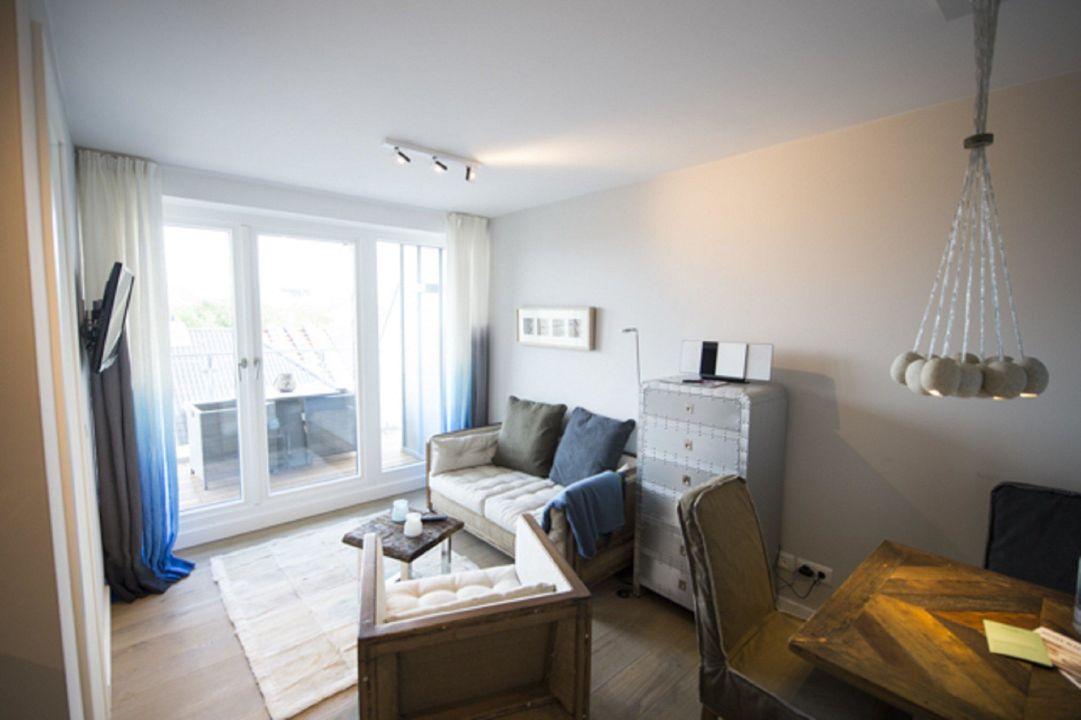 Wohnzimmer mit loggia oder terrasse hotel 54 grad nord for Design hotel 54 nord