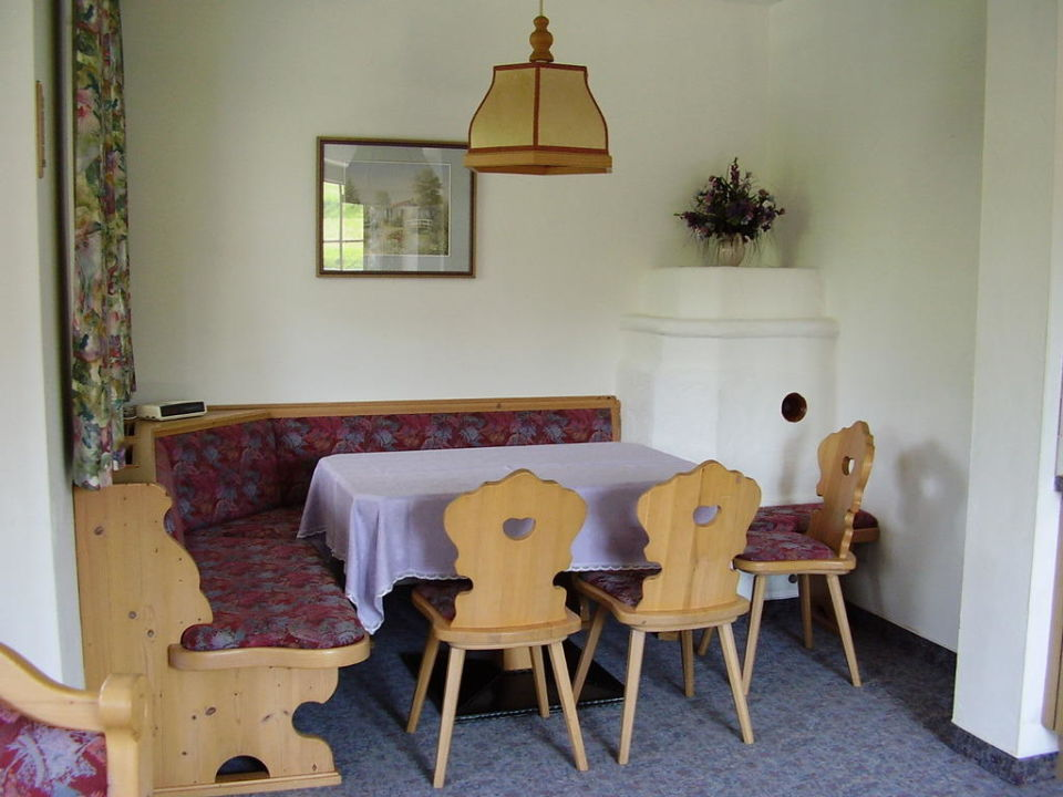 Essecke mit Kamin Appartements Schedererhaus