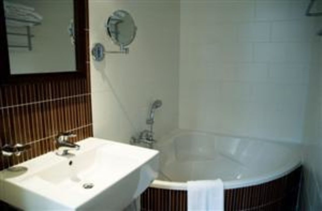 Salle de bain chambre deluxe\