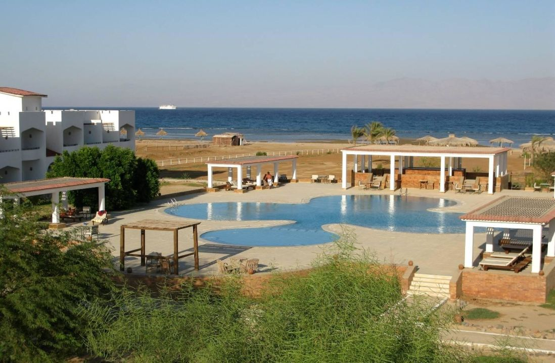 View of the pool, rooms and beach Swisscare Nuweiba Resort Hotel