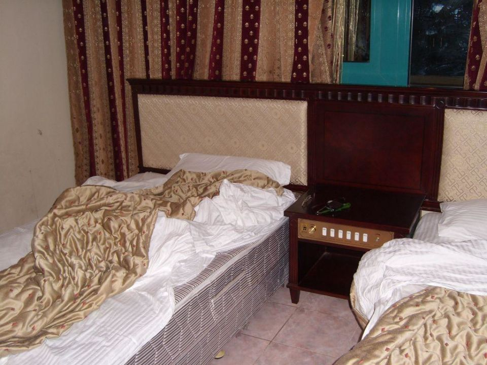 Schlafzimmer The Suites Hotel Apartments
