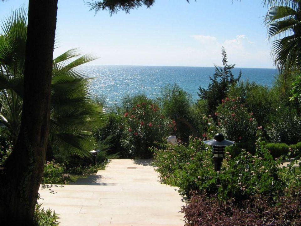 Weg über Stufen zum Meer Hotel Melas Resort