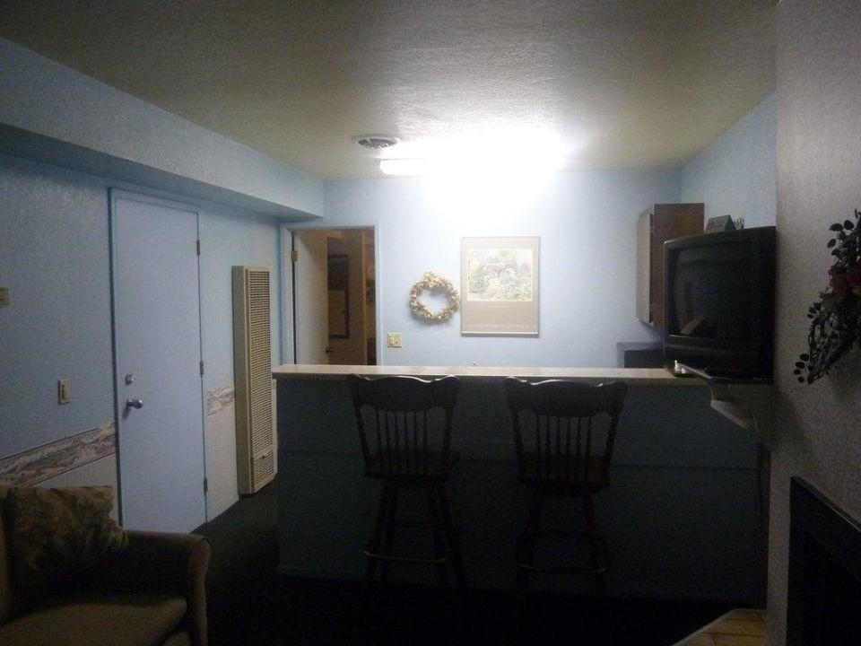 Wohnzimmer Mit Küche/Bar, Rechts Ein Gaskamin Hotel Beachwalker Inn