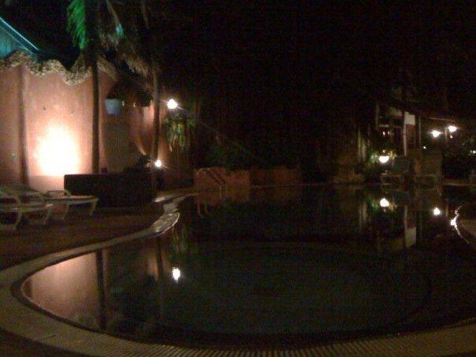 Pool at nighttime Corto Maltese Resort