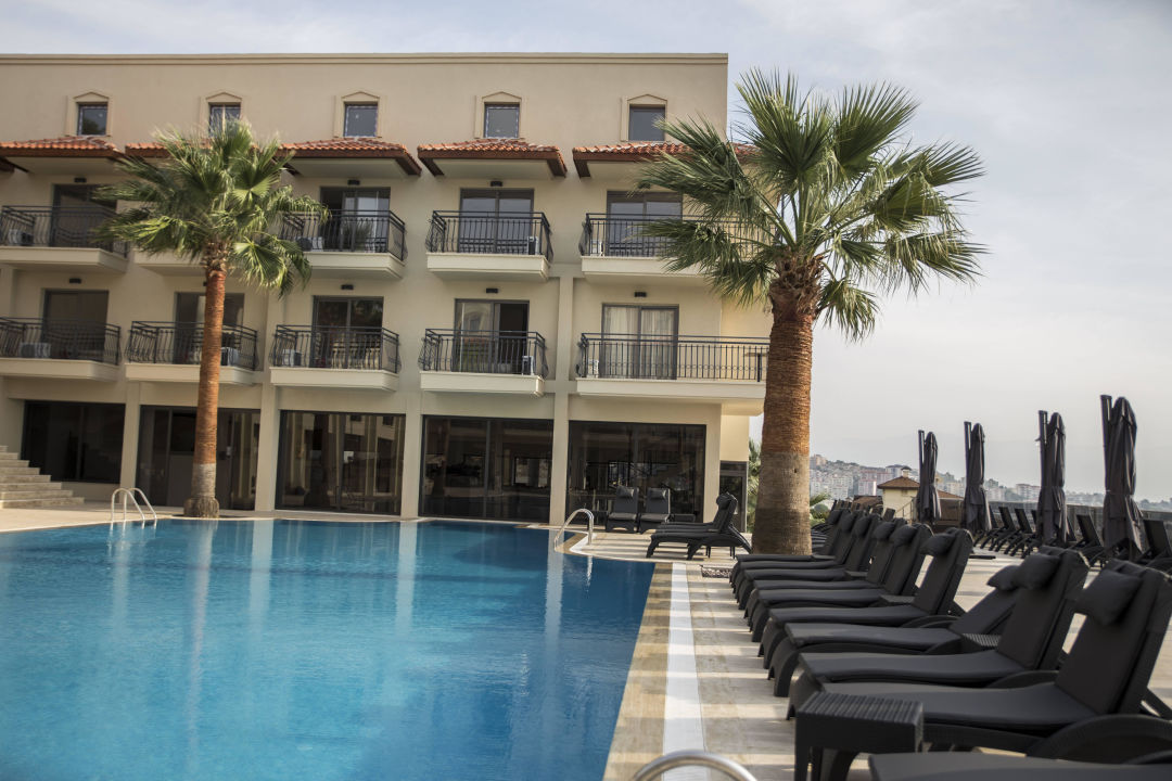 Swimming pool, lounge beds & main building\