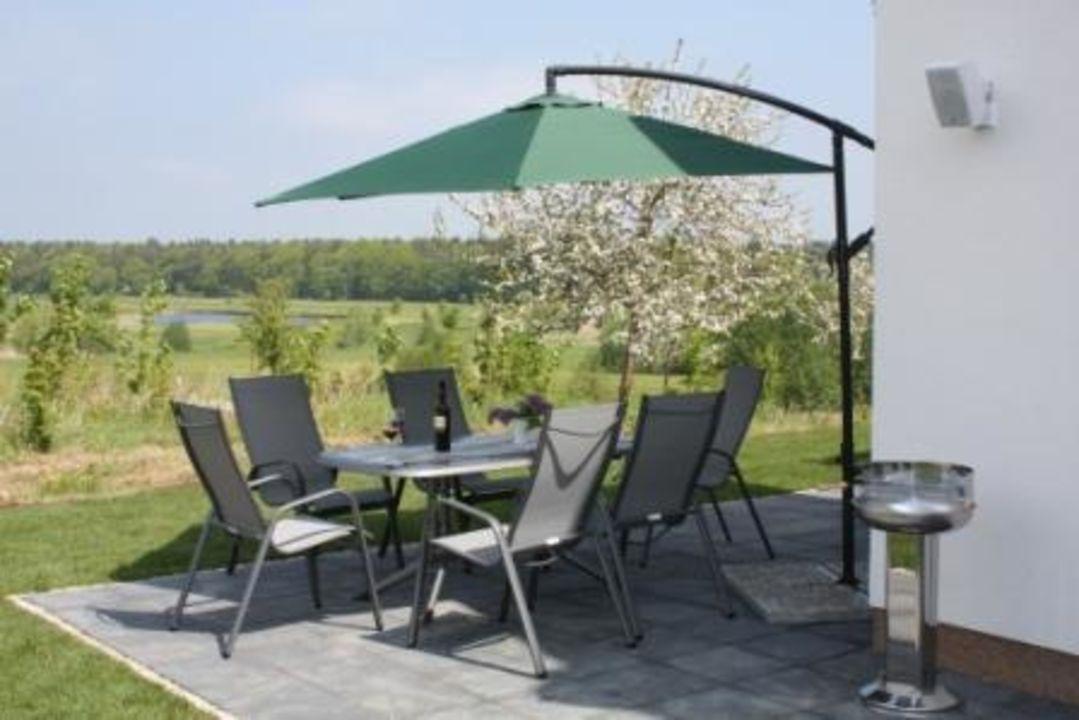 Sonnenterrasse mit Ausblick auf den Golfplatz Villa Royal