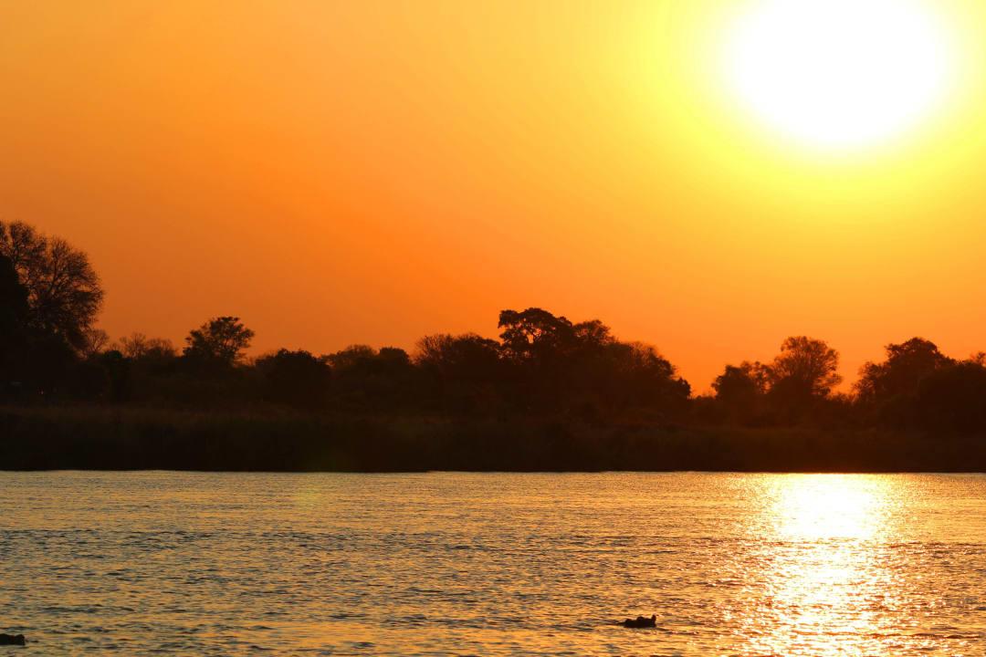 Sonnenuntergang am Okavango Nunda River Lodge