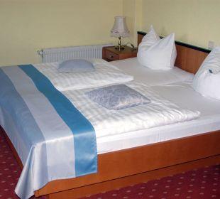 Betten mit abendlicher Schoki auf den Kissen Hotel Seelust