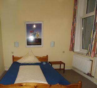 Schlafzimmer ALPHA Hotel Garni