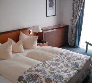Blick auf das Bett Hotel Alexander am Zoo