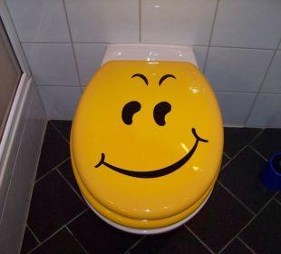 WC-Deckel mit passendem Motiv Smile Hotel