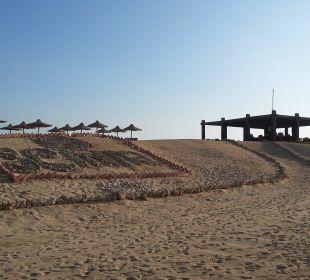 Laguna-Bar mit Gemma Schriftzug im Sand