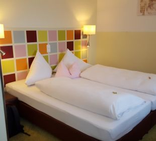 Bett Hotel Arooma