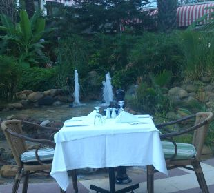 Table set for dinner in smoking area Hotel Aqua