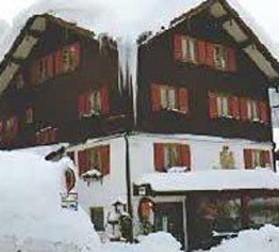Haus im Winter Gästehaus Brugger