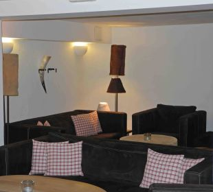 Einer der verschiedenen Aufenthaltsräume Hubertus Alpin Lodge & Spa