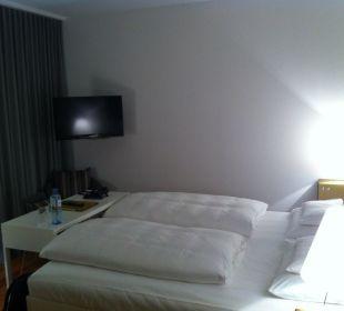 Bett mit Flat TV Hotel am See