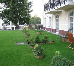 Garten gehört zu den Zimmern im unterem Bereich Baltic Home Apartments