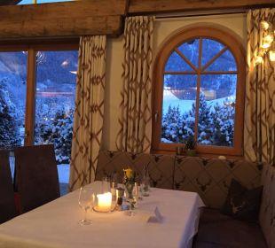 Ausblick auf die Abendschneelandschaft Verwöhnhotel Berghof