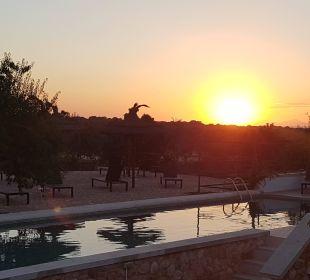 Der Pool während dem Sonnenuntergang Finca Es Pinaretta