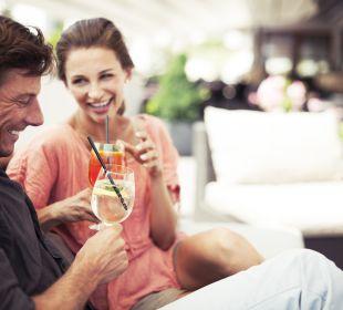 Einen Drink auf der Terrasse genießen Sporthotel Brugger