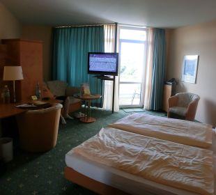 Schlafbereich mit Schreibtisch und Sitzecke Ringhotel Roggenland