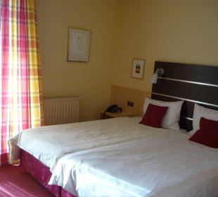 Bett von Zimmer 2 Hotel Uhu Köln