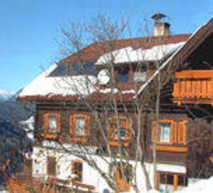 Haus im Winter Sportbauernhof Hochalmblick
