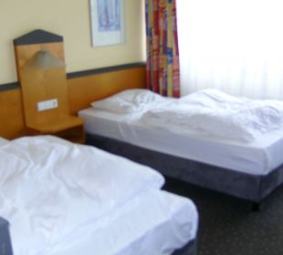 Betten auch als Doppelbett da Victor's Residenz Hotel Berlin Tegel