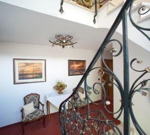 Treppenhaus mit Sitzgruppe Gästehaus Hotel Garni Zibert
