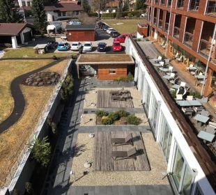 Blick vom Zimmer auf Atrium und Aussensauna Hotel Exquisit