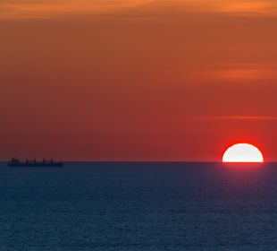 Sonnenuntergang von der Dachterrasse Ferienwohnung Utjeha.me