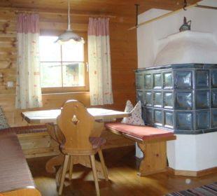 Sitzecke mit Holzkachelofen Appartement Bergblick Wörglerhof Alpbacher Hüttenappartements & Saunaalm