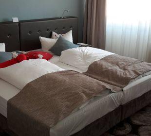 Das Bett Superior Zimmer Victor's Residenz Hotel Berlin Tegel