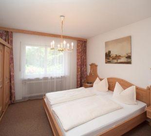 Schlafzimmer im Ferienbunalow Gästehaus Hotel Garni Zibert