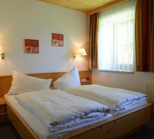 Schlafzimmer Apartment Landgasthof Sonnblick