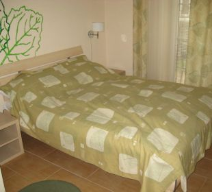 Bett im Zimmer Baltic Home Apartments