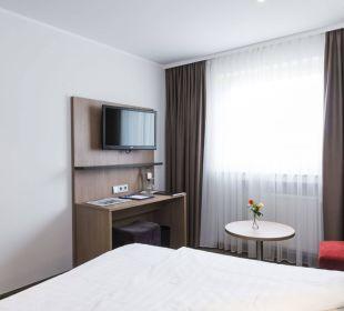 Zimmer Flatscreen Astor und Aparthotel