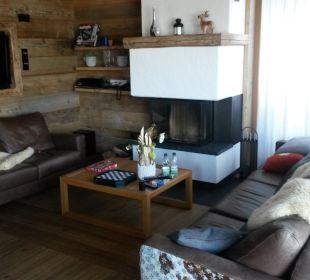 Wohnzimmer mit Kamin Maierl-Alm & Chalets